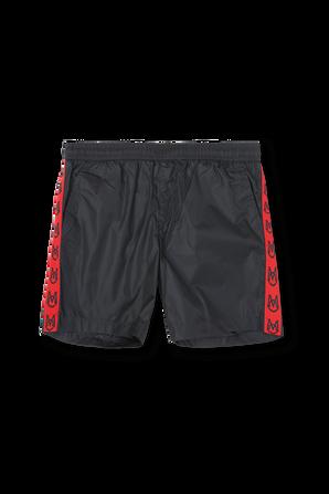גילאי 4-6 מכנסי גלישה קצרים בכחול כהה עם לוגוסטריפ אדום MONCLER KIDS